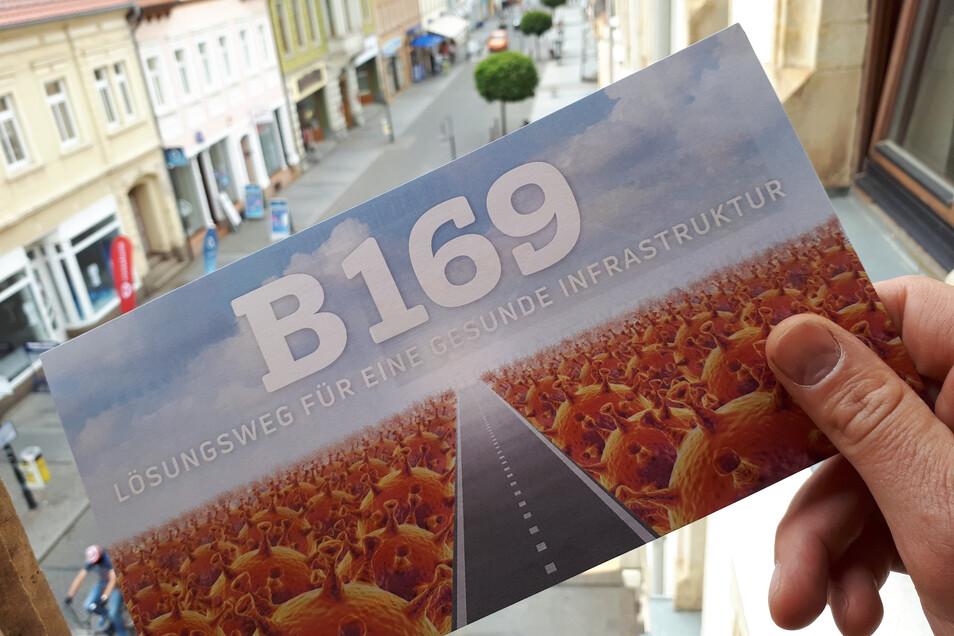 Die B 169 - der Lösungsweg für eine gesunde Infrastruktur. So sieht man es beim Wirtschaftsforum Riesa und verschickt Karte Nr. 63 mit Coronavirus-Motiv.