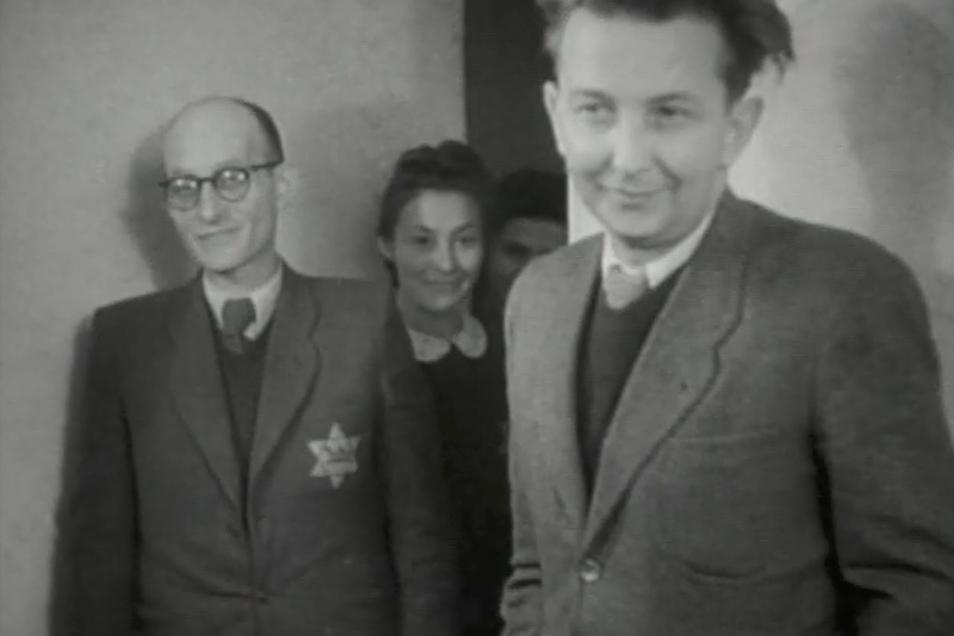 Alfred Roßner (r.) um 1941 mit seinem Buchhalter Josef Sapir und der Angestellten Laja Jachimowicz.