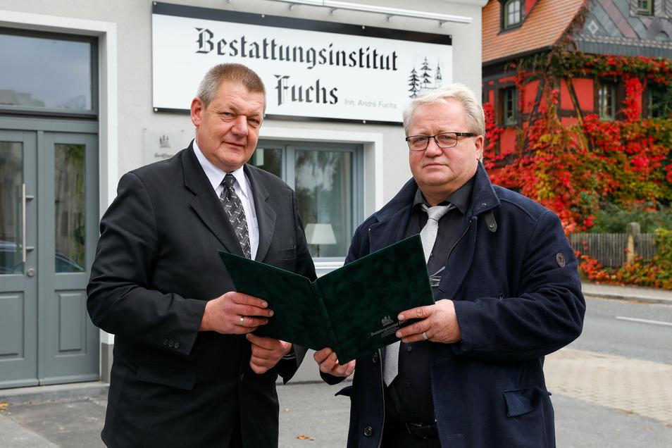 Andreas Räffler (links) und sein Chef André Fuchs (rechts) arbeiten nun in den neuen Büroräumen auf der Hammerschmiedtstraße.