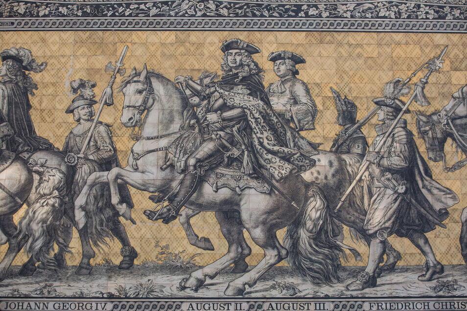 In der zweiten Sphäre plaudert August der Starke, hier auf dem Fürstenzug, ganz locker mit seinem Hofarchitekten Pöppelmann über die Entwicklung des Zwingers..