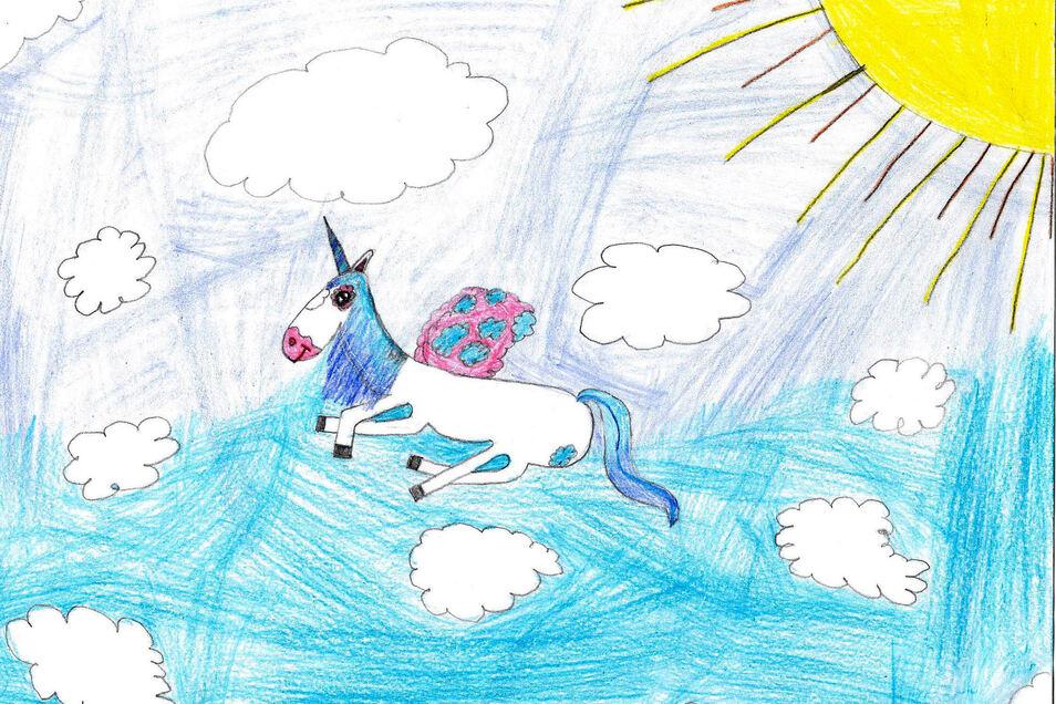 """Jessica Kühnberger findet Einhörner super und malte deshalb mit Buntstift """"Das magische Einhorn"""". """"In meinen Träumen haben sie die schönsten Farben und fliegen durch den Himmel"""", sagt die Neunjährige."""