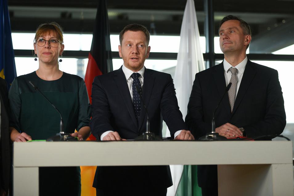 Katja Meier (Grüne), Michael Kretschmer (CDU, Mitte) und Martin Dulig (SPD) sind auch als Konfliktmanager gefragt.