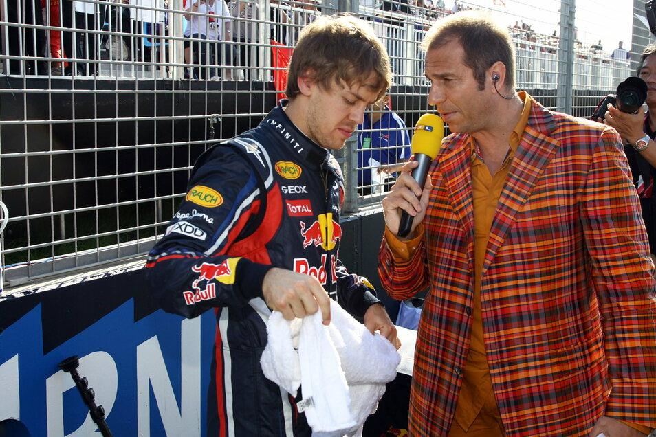 Vor fast zehn Jahren: Sebastian Vettel (l.), damals bei Red Bull unter Vertrag, spricht mit RTL-Moderator Kai Ebel.