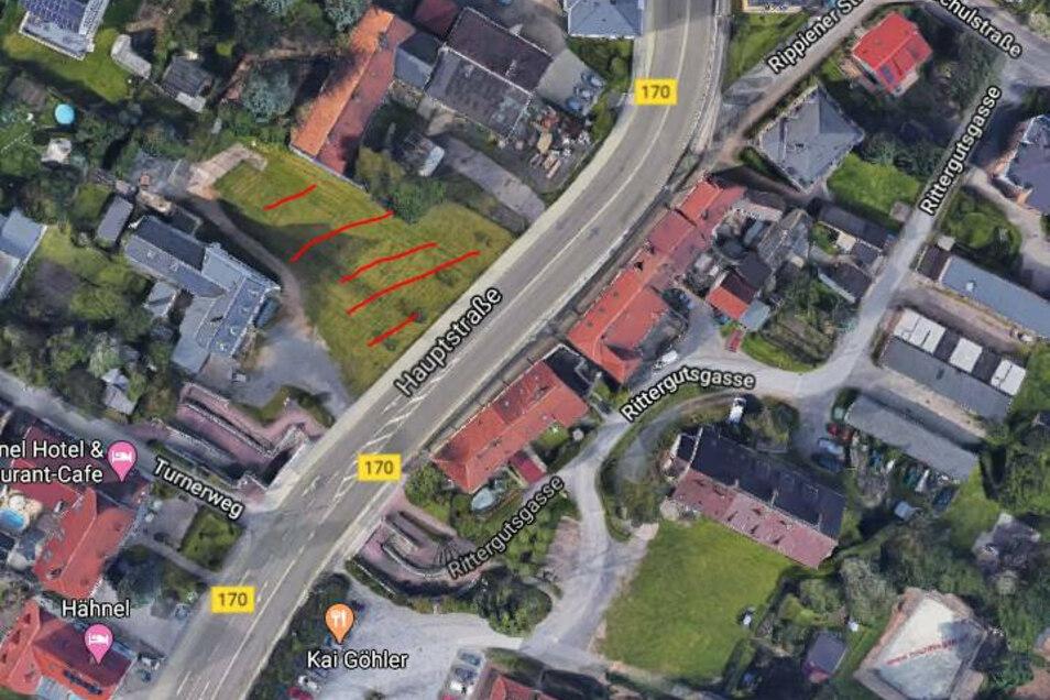 Die rot schraffierte Fläche neben der B 170 wird verkauft. Auf dem Gelände in Possendorf sollen Wohn-und Geschäftshäuser entstehen.