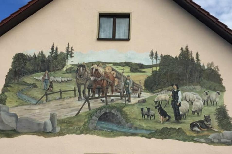 Dieses Gemälde ziert die Wand eines Wohnhauses.