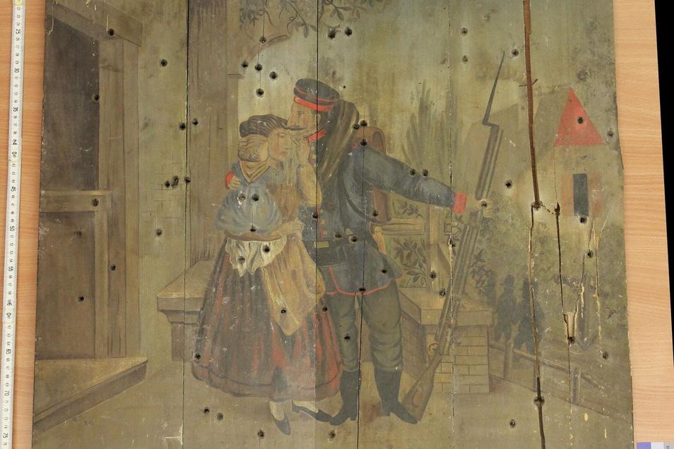 Die Schützenscheibe zeigt einen Soldaten, der sich von seiner Familie verabschiedet.