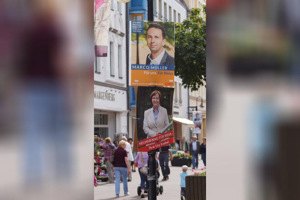 Fast sieben Jahre her: Im Sommer 2014 kandidierten Marco Müller und Uta Knebel – hier Wahlplakate von der Riesaer Hauptstraße – um den OB-Posten. Zuvor war Gerti Töpfer zurückgetreten. Das Duell Müller/Knebel wird sich 2021 aber nicht wiederholen.