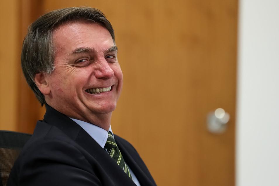 Jair Bolsonaro hat gut Lachen: Trotz steigender Corona-Zahlen demonstrieren Menschen in seinem Land für ihn.