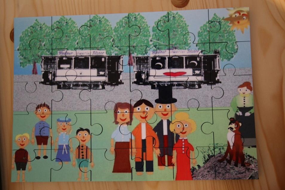 """Für die Kleinsten wurde ein Puzzle aus Holz mit einem Motiv aus dem Kinderbuch """"Fritz und die wundersame Geschichte der alten Pferdebahn"""" der Roßweiner Autorin Hannelore Jost verwendet."""