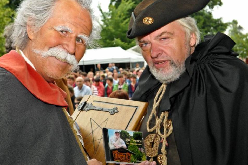 Die bekannten sorbischen Sagenfiguren Krabat und der Schwarze Müller.