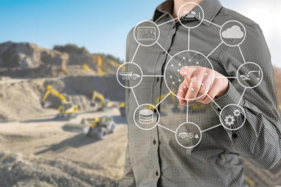 Kommunikation ist auf der Baustelle der Zukunft alles. Baumaschinen und Menschen, Menschen und Computer tauschen permanent Informationen aus.