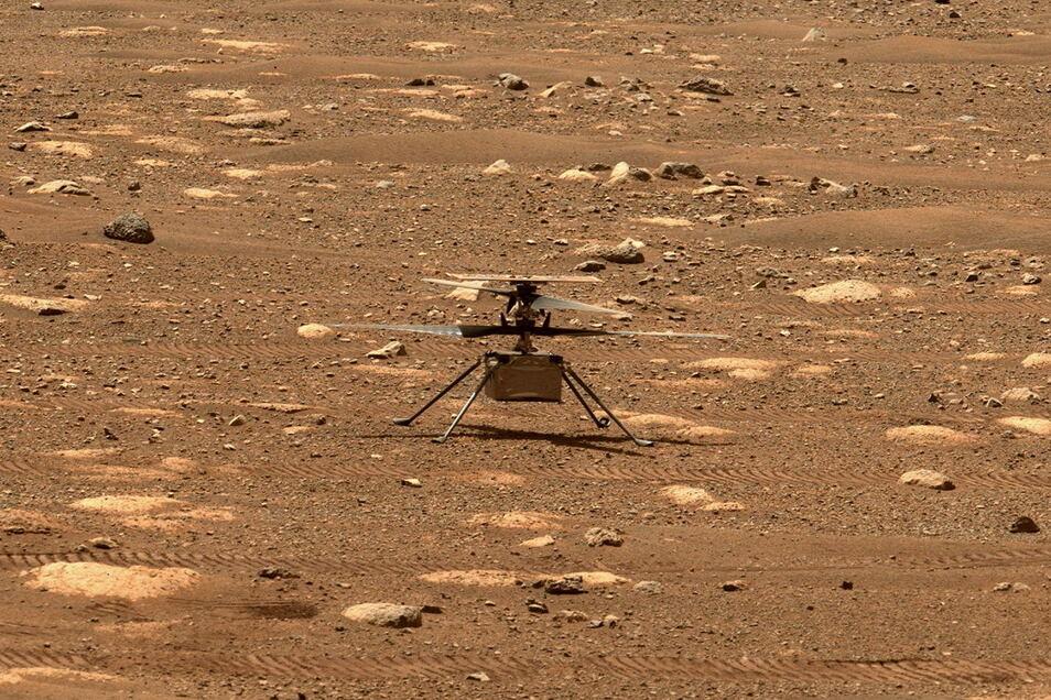 """Mit dem Mars-Hubschrauber """"Ingenuity"""" hat erstmals ein Luftfahrzeug einen Flug auf einem anderen Planeten absolviert."""