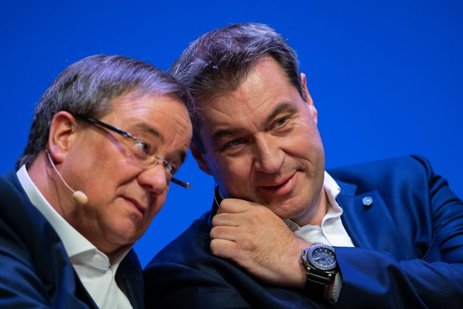 Die aussichtsreichten Kandidaten, nächster Kanzler zu werden: Armin Laschet (CDU, l), und Markus Söder (CSU).